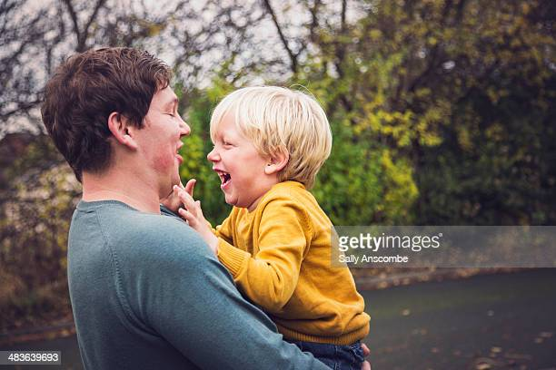 Father and son laughing together