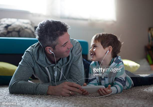 Father and son listening music.