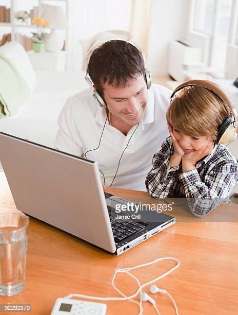 Father and son listening to music together