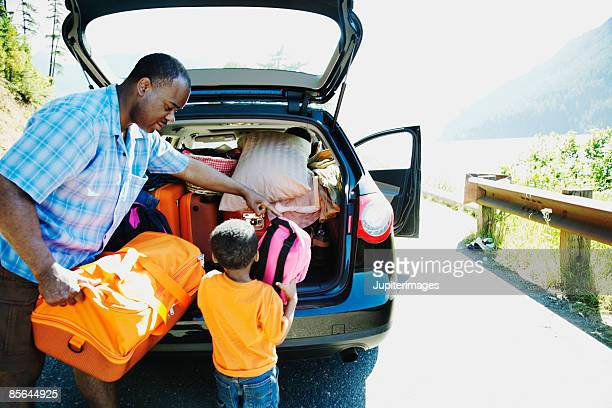 Father and son loading car