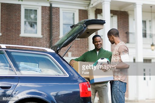 Father and Son Loading the Car
