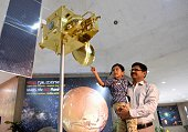 A father and son look at a scale model of India's Mars Orbiter spacecraft at the Nehru Planetarium as a special preview on the Mars Orbiter Mission...