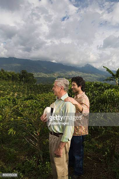 Father and son looking at coffee plantation , Colombia