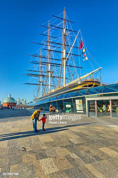 Father and son looking at Cutty Sark tea clipper after restoration in Greenwich London United Kingdom