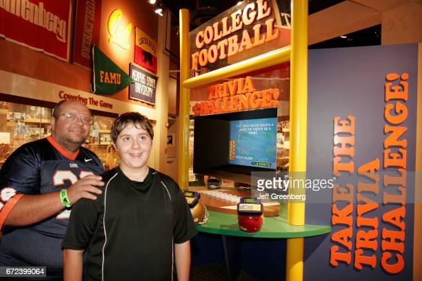 A father and son looking at exhibits at the College Football Hall of Fame