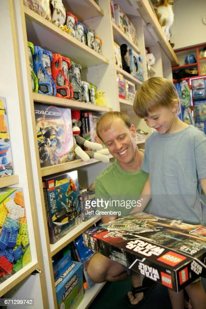A father and son looking at Lego Star Wars in Toy Harbor