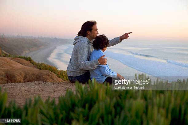 Father and son looking at ocean