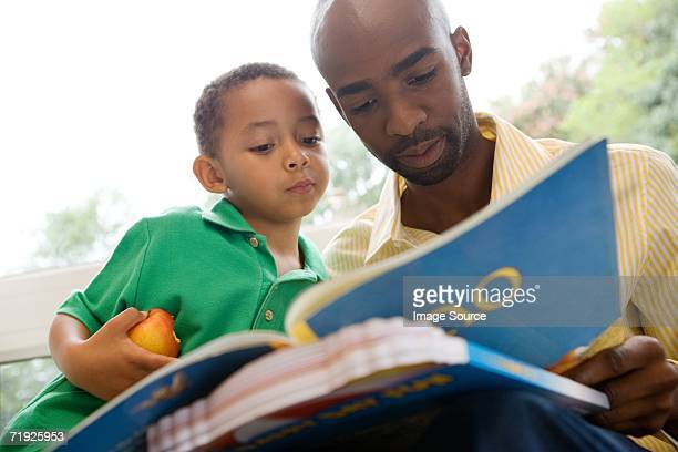 Father and son looking at picture book