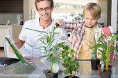Father and son making a terrarium