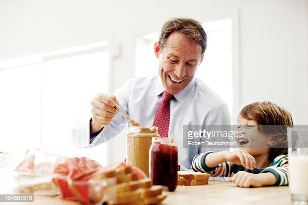Father and son making lunch