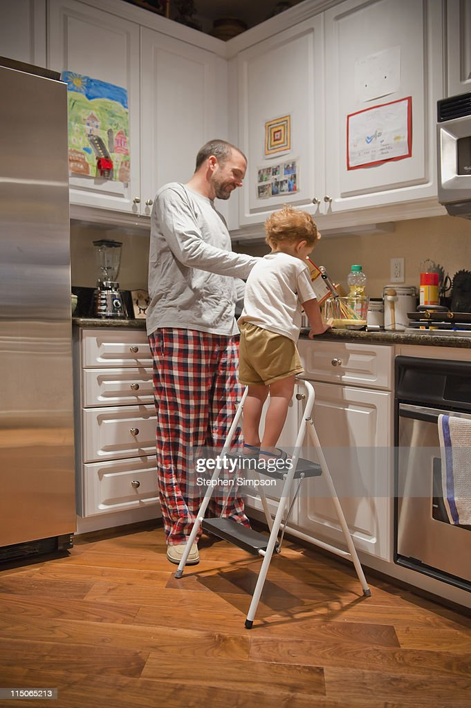 father and son making pancakes : Stock Photo