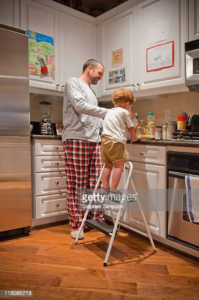 father and son making pancakes