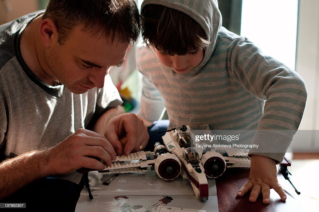 Father and son making spacecraft : Stock Photo