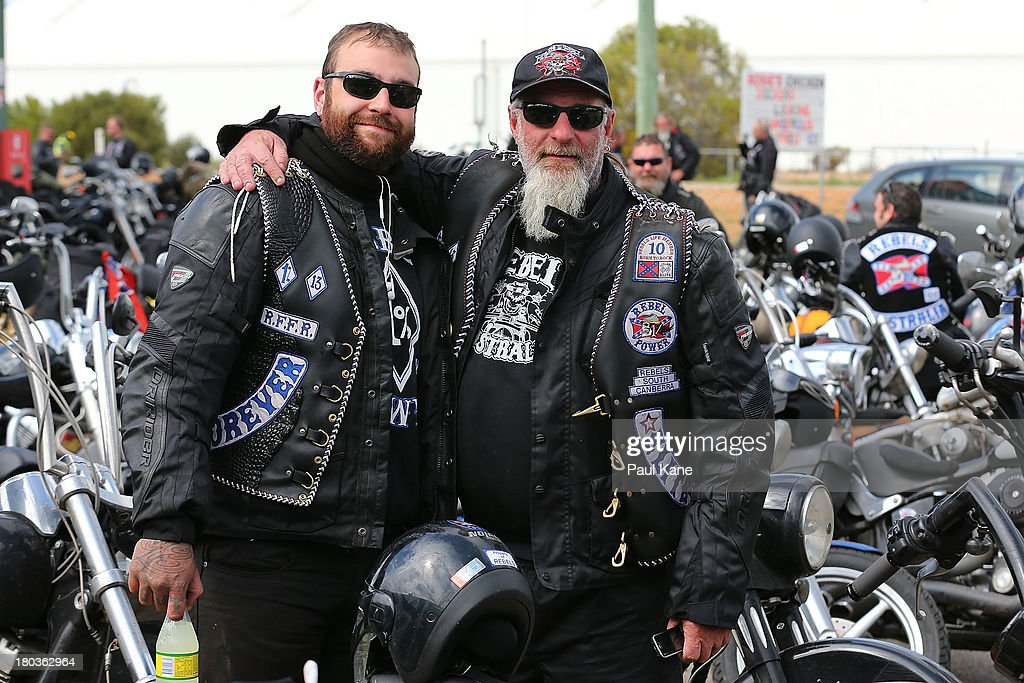 Father and son members of the Rebels motorcycle club pose for a photo during a regroup at the Tammin roadhouse onroute to the Perth CBD on September 12, 2013 in Perth, Australia. An estimated 1000 Rebels from chapters all over Australia gather for the road trip across the country to Perth.
