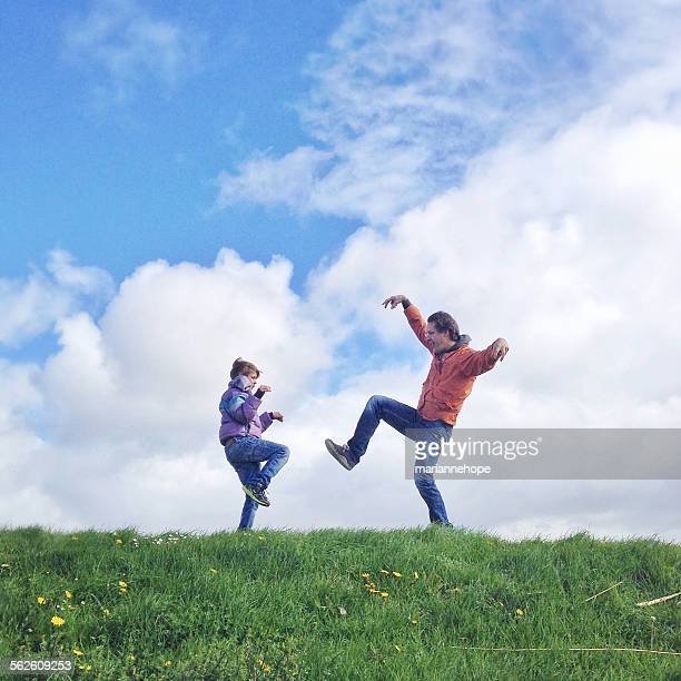 Father and son messing about in the countryside