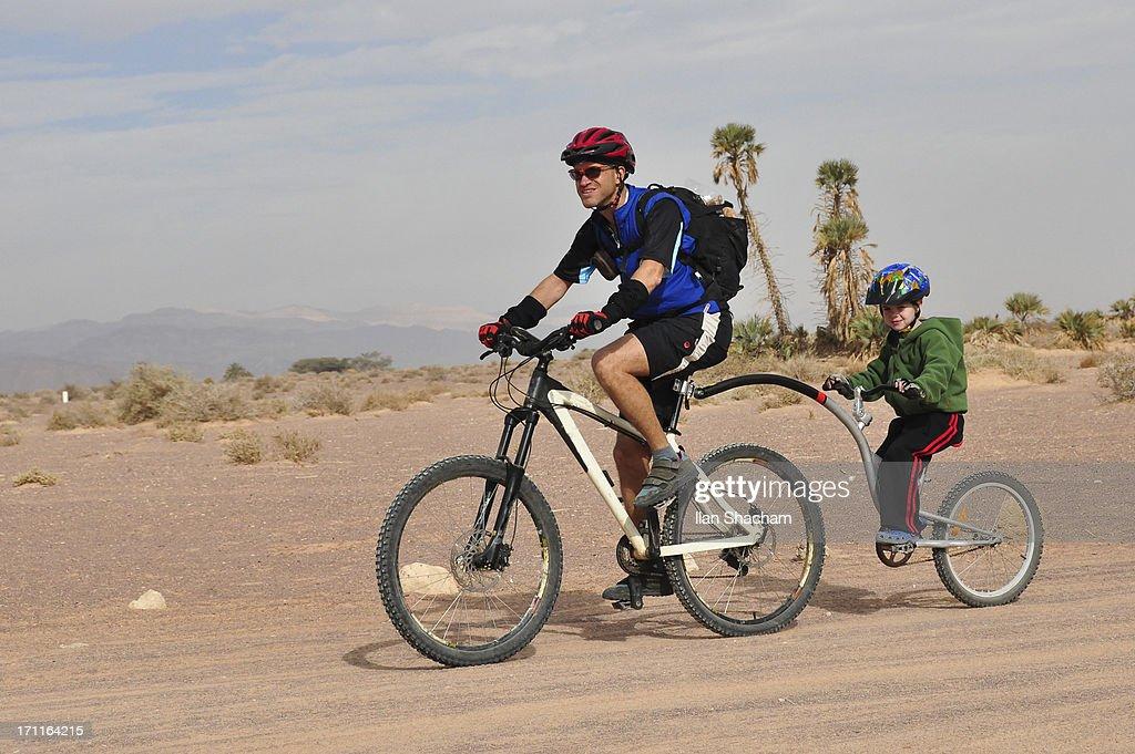 Father and son mountain biking