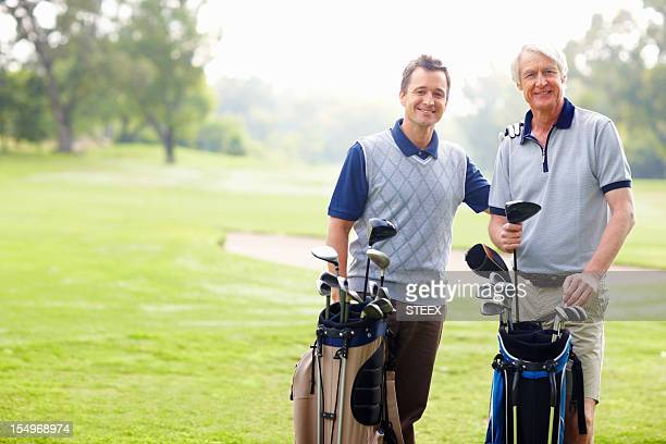 Father and son on a golf course