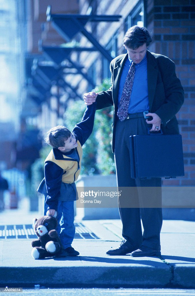 Father and Son on a Sidewalk