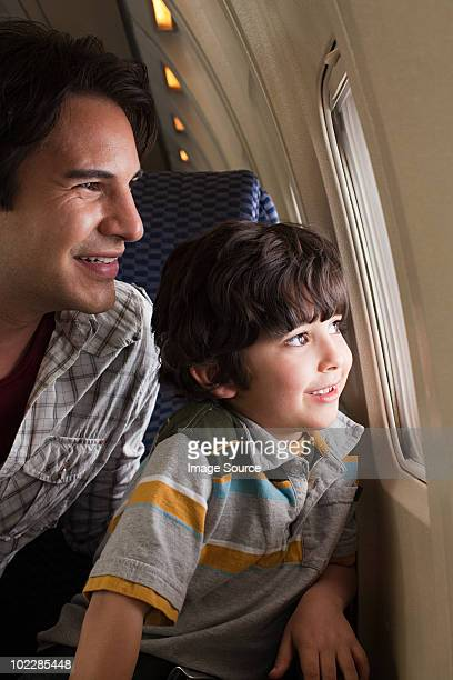 Father and son on an airplane