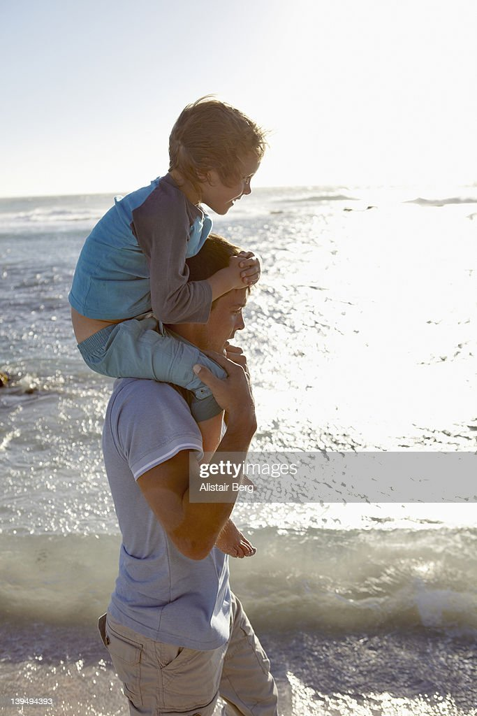 Father and son on beach : Stock Photo