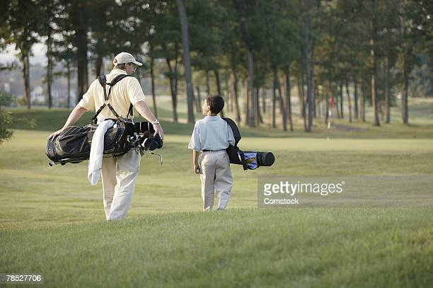 Father and son on golf course