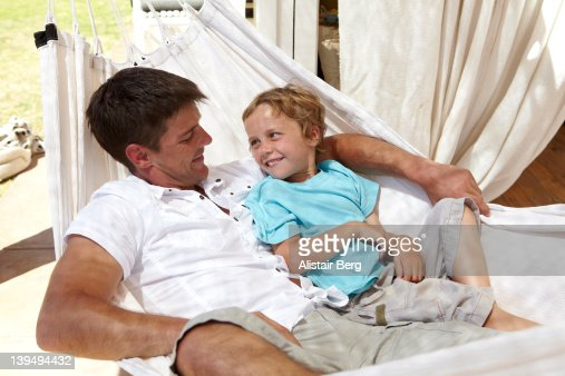 Father and son on hammock : Stock Photo