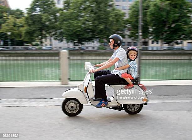 father and son on scooter