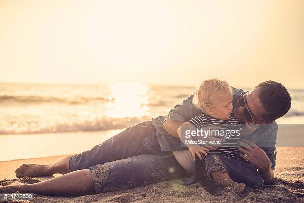 Father and son on the beach