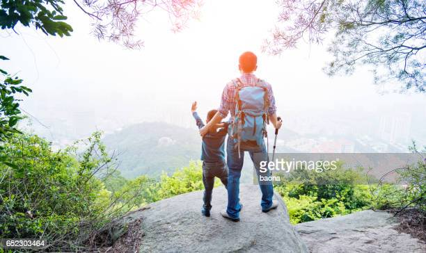 Father and son on the top of the hill