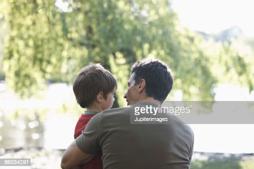 Father and son outdoors : Stock Photo