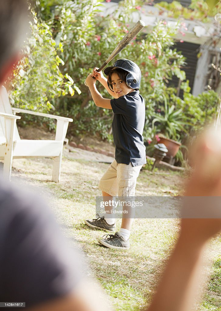 Father and son playing baseball outdoors : Stock Photo