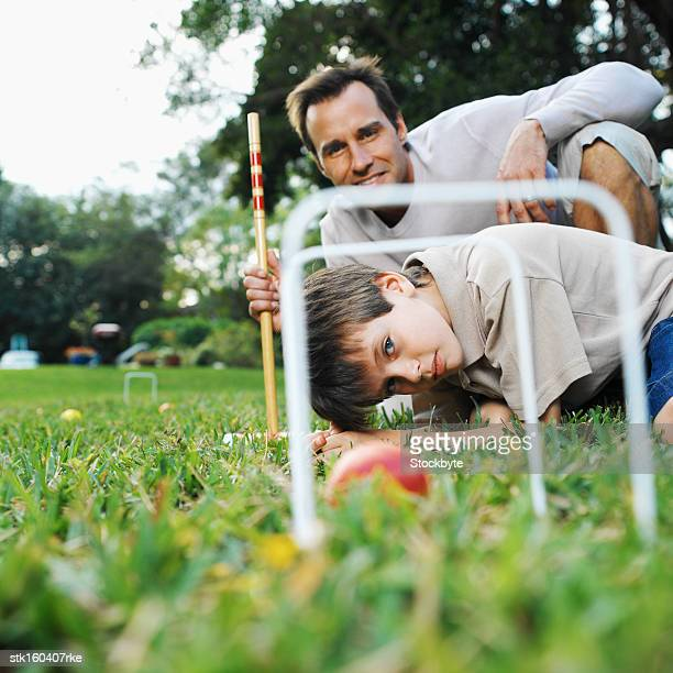 father and son playing croquet