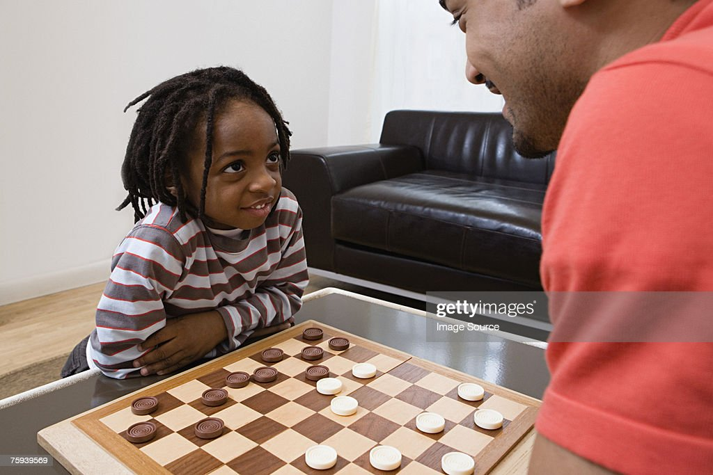 Father and son playing draughts
