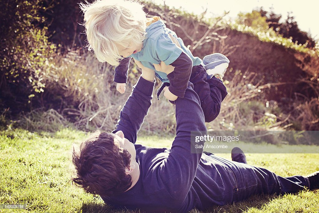 Father and son playing in garden : Stock Photo