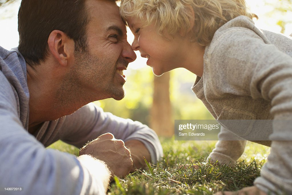 Father and son playing in grass : Stock Photo