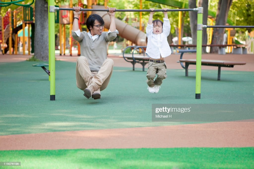 Father and son playing in park : Stock Photo