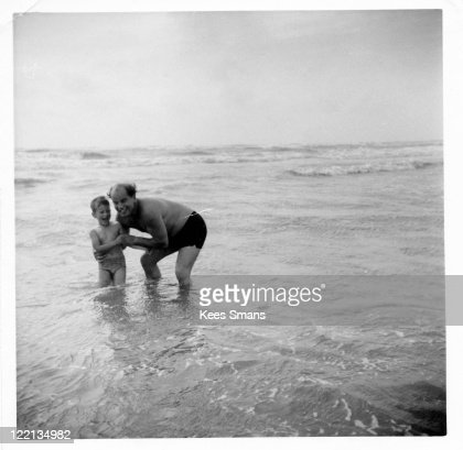 Father and son playing in sea : Stock Photo