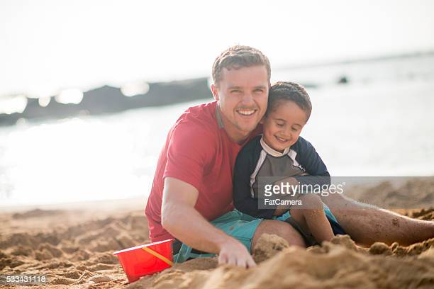Father and Son Playing in the Sand