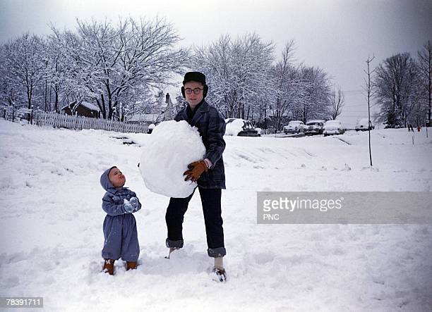 Father and son playing in the snow