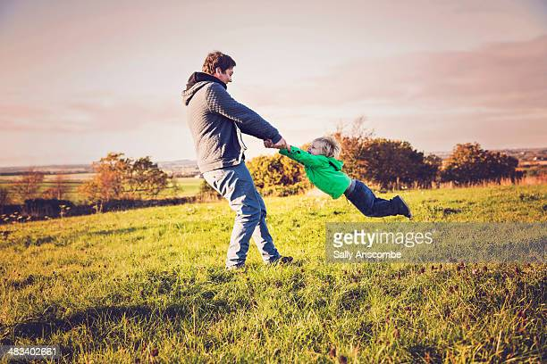 Father and son playing outdoors