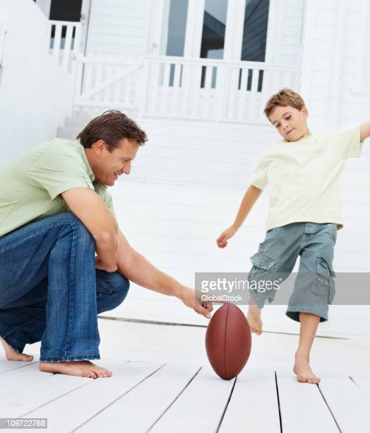 Father and son playing rugby