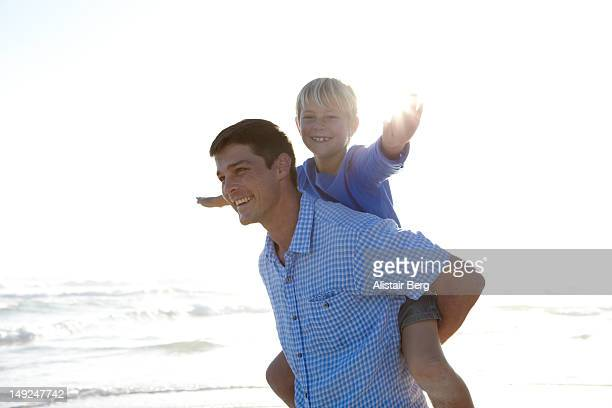 Father and son playing together on a beach