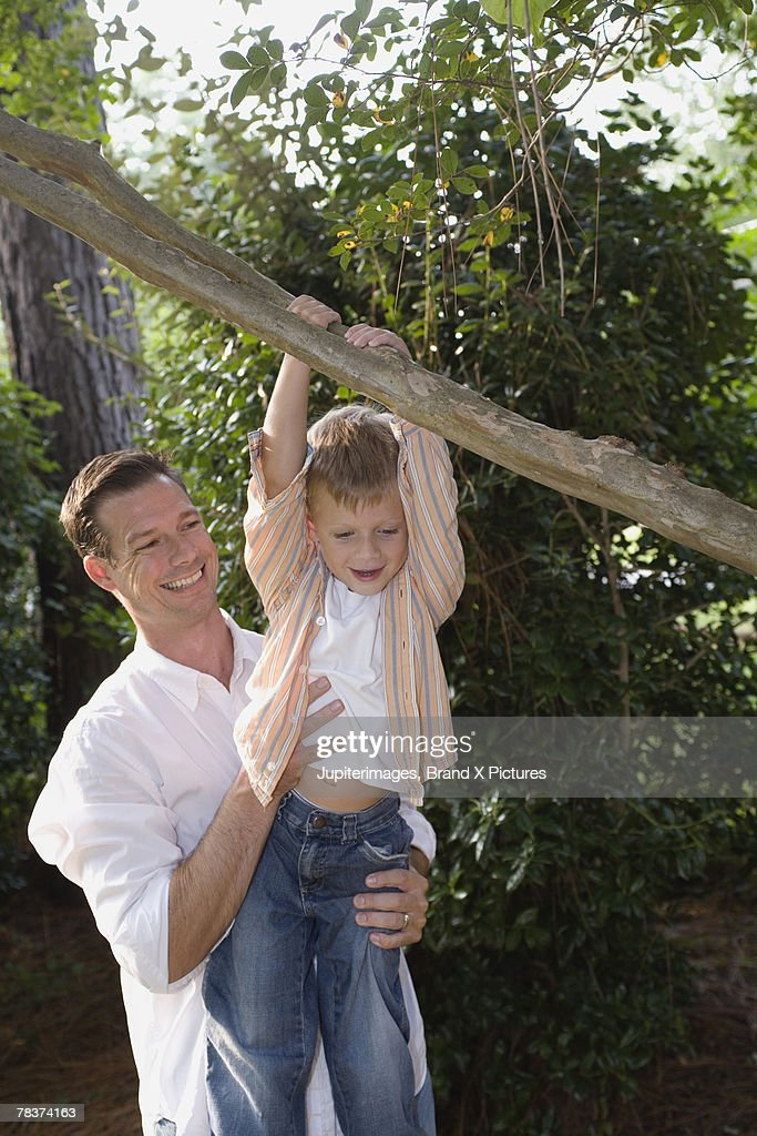 Father and son playing together : Stock Photo