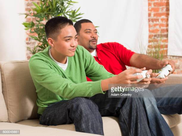 Father and son playing video games together