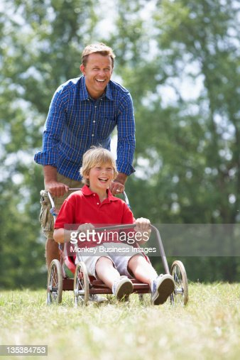 Father and son playing with go-kart : Stock Photo