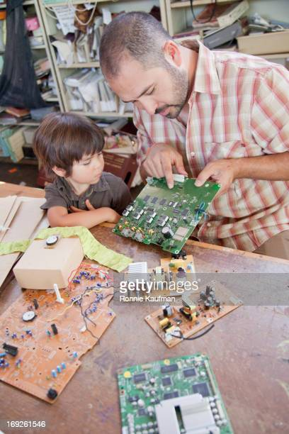 Father and son playing with microchips