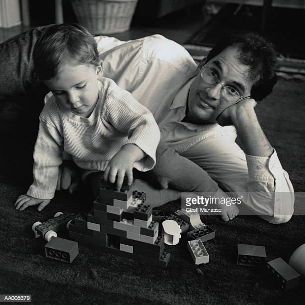 Father and Son Playing with Plastic Blocks