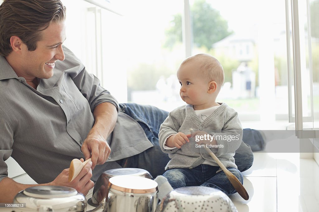 Father and son playing with pots and pans : Stock Photo