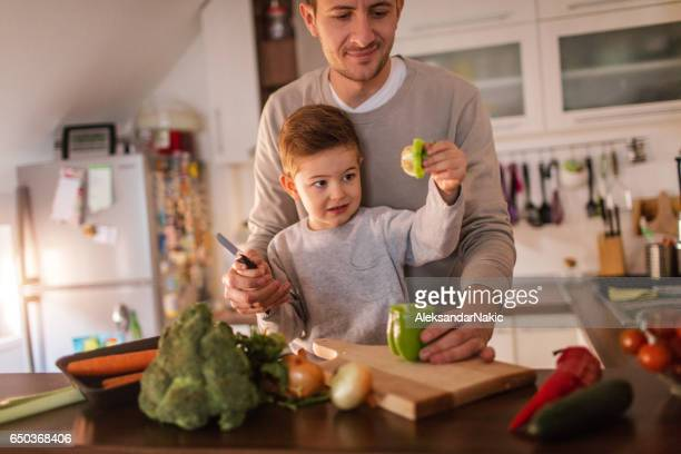 Father and son preparing healthy food in the kitchen
