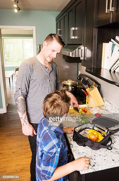 Father and son preparing school lunch